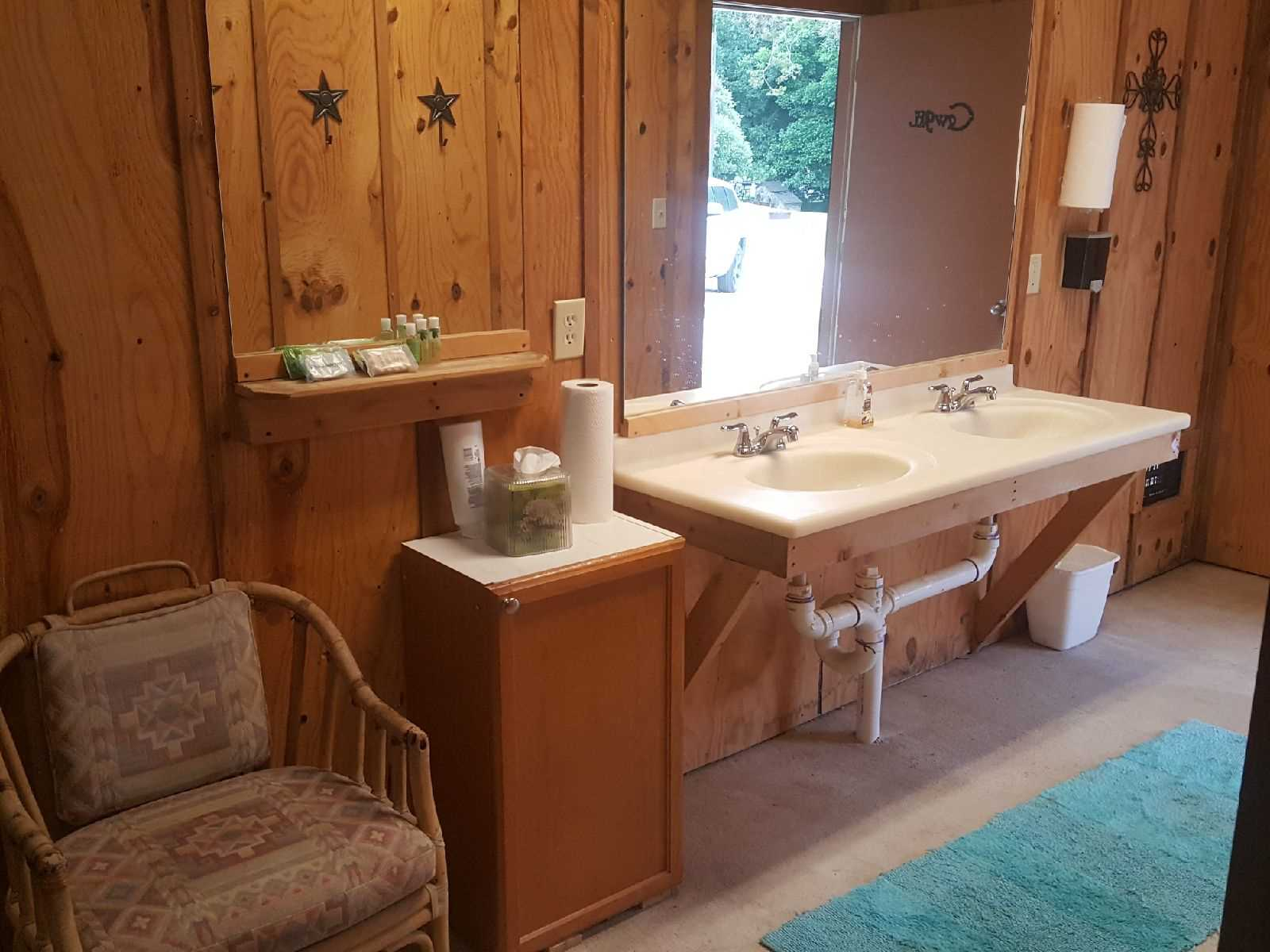 You'll find double vanities, a shower, and a washer and dryer combo in the Bath House-and all bath linens are provided.
