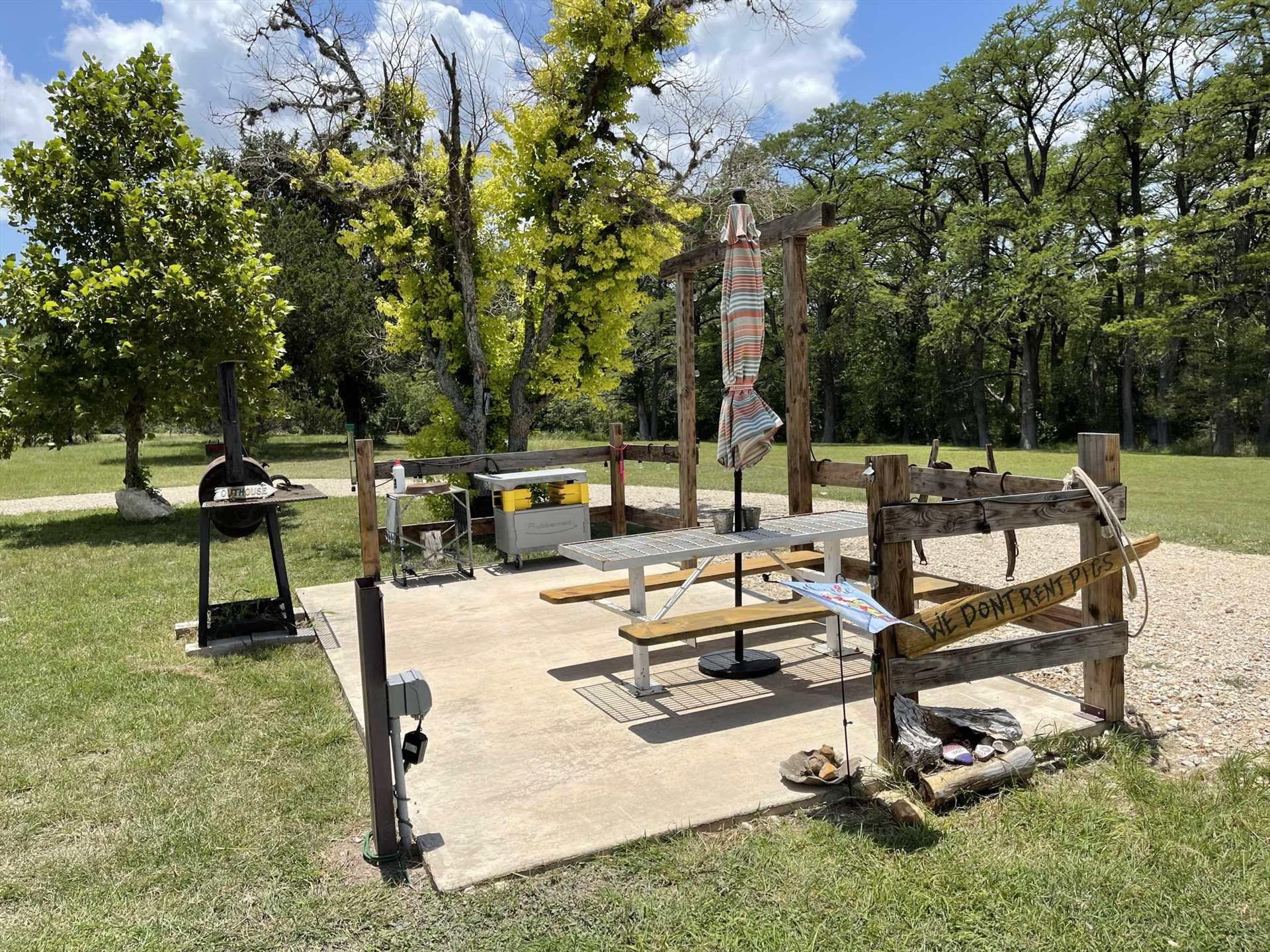 With a charcoal grill right there, the dedicated picnic area helps make outdoor feasts a snap!