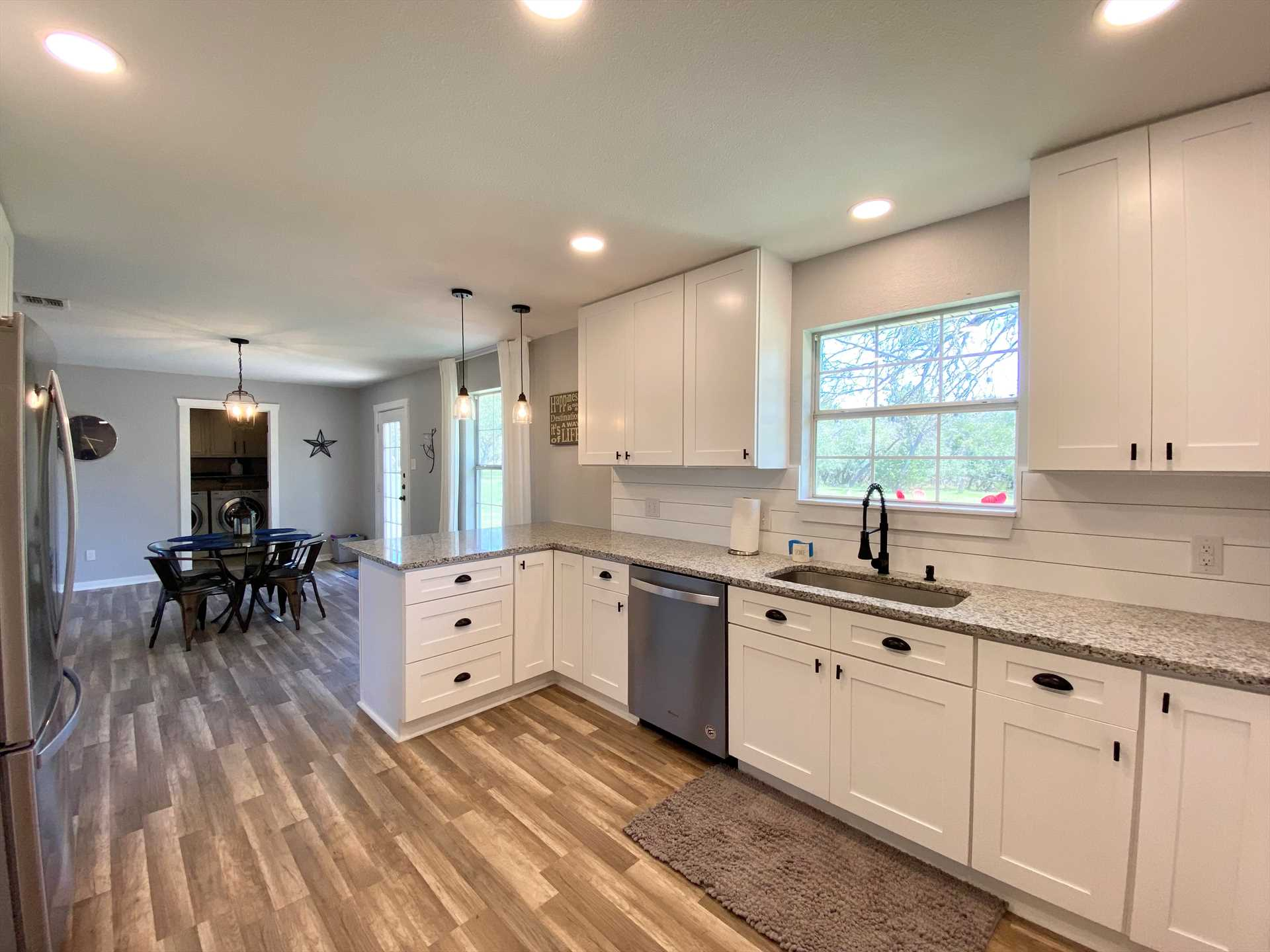 Modern appliances and plenty of counter space on sparkling granite counter tops make the kitchen a joy for cooks to show off their skills!