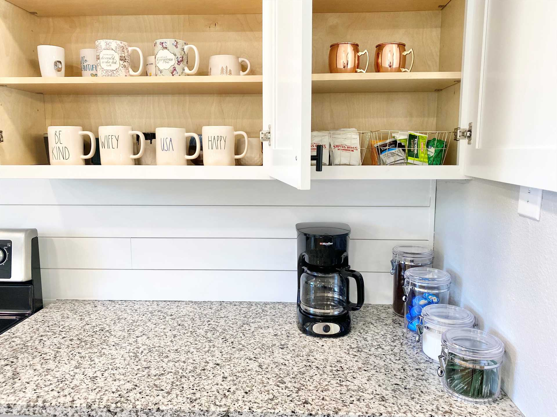 Coffee, tea, hot chocolate, and cups are provided for those all-important morning pick-me-ups. There's also plenty of cookware, utensils, and serving ware here.