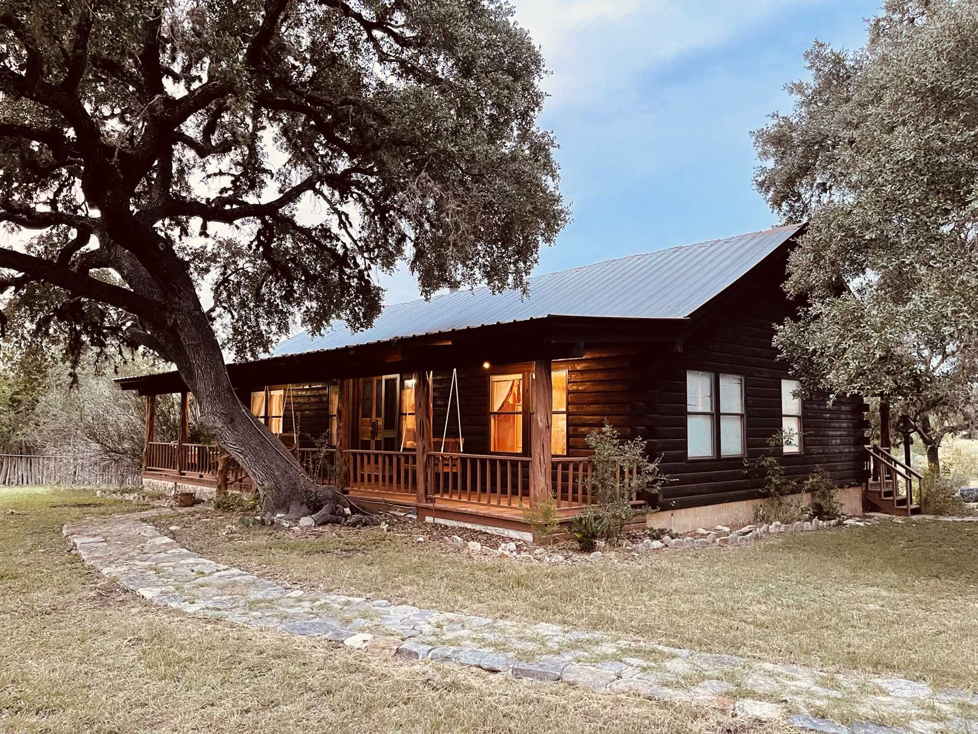 The peaceful shaded deck comes with outdoor lighting and a porch swing, and stretches the entire length of the Lodge. It's a fantastic spot to take in the beauty of the Hill Country!