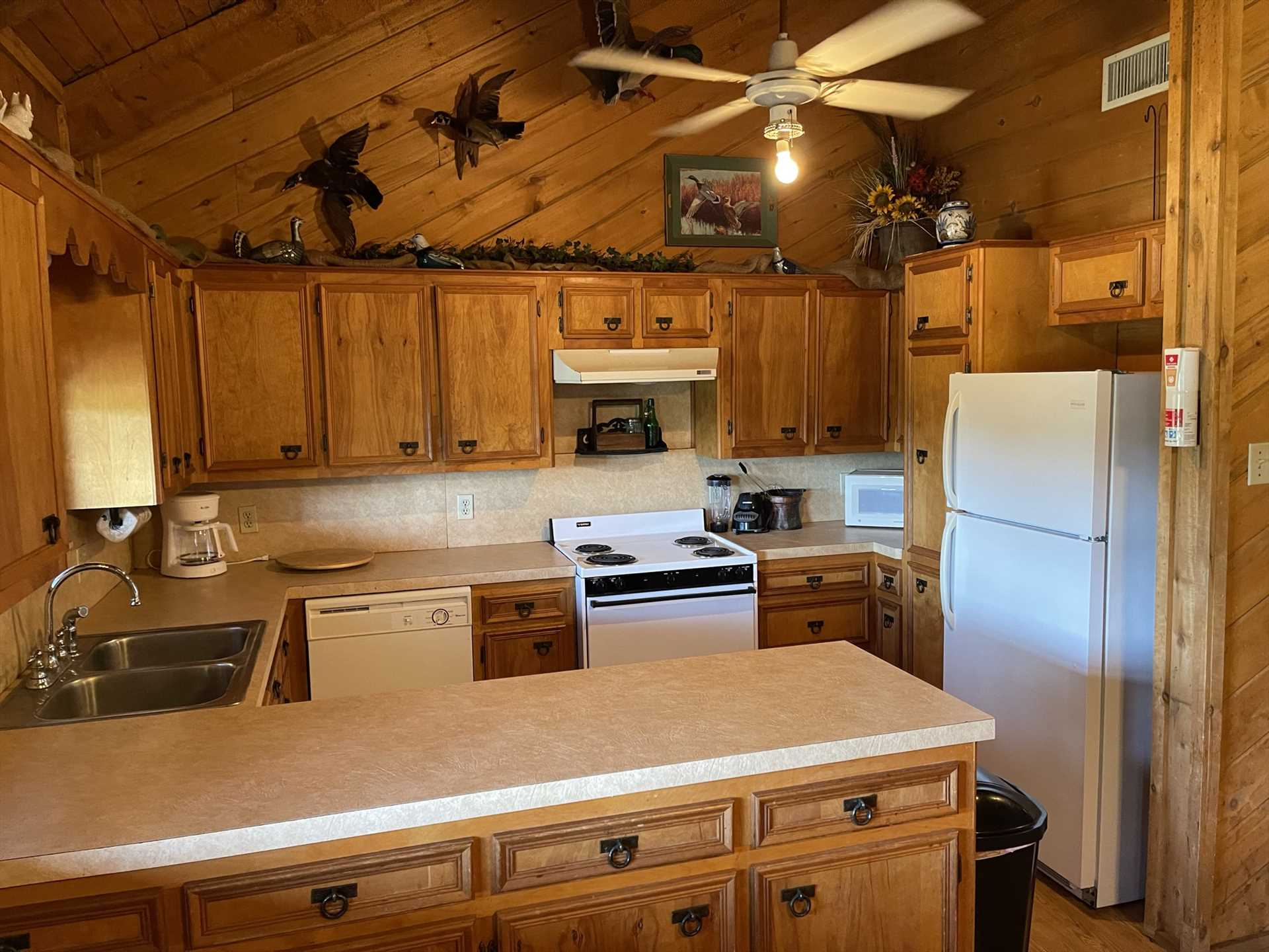 Culinary masters will love the roomy country kitchen, decked out with all the appliances, cookware, serving ware, glasses and utensils you'll need!