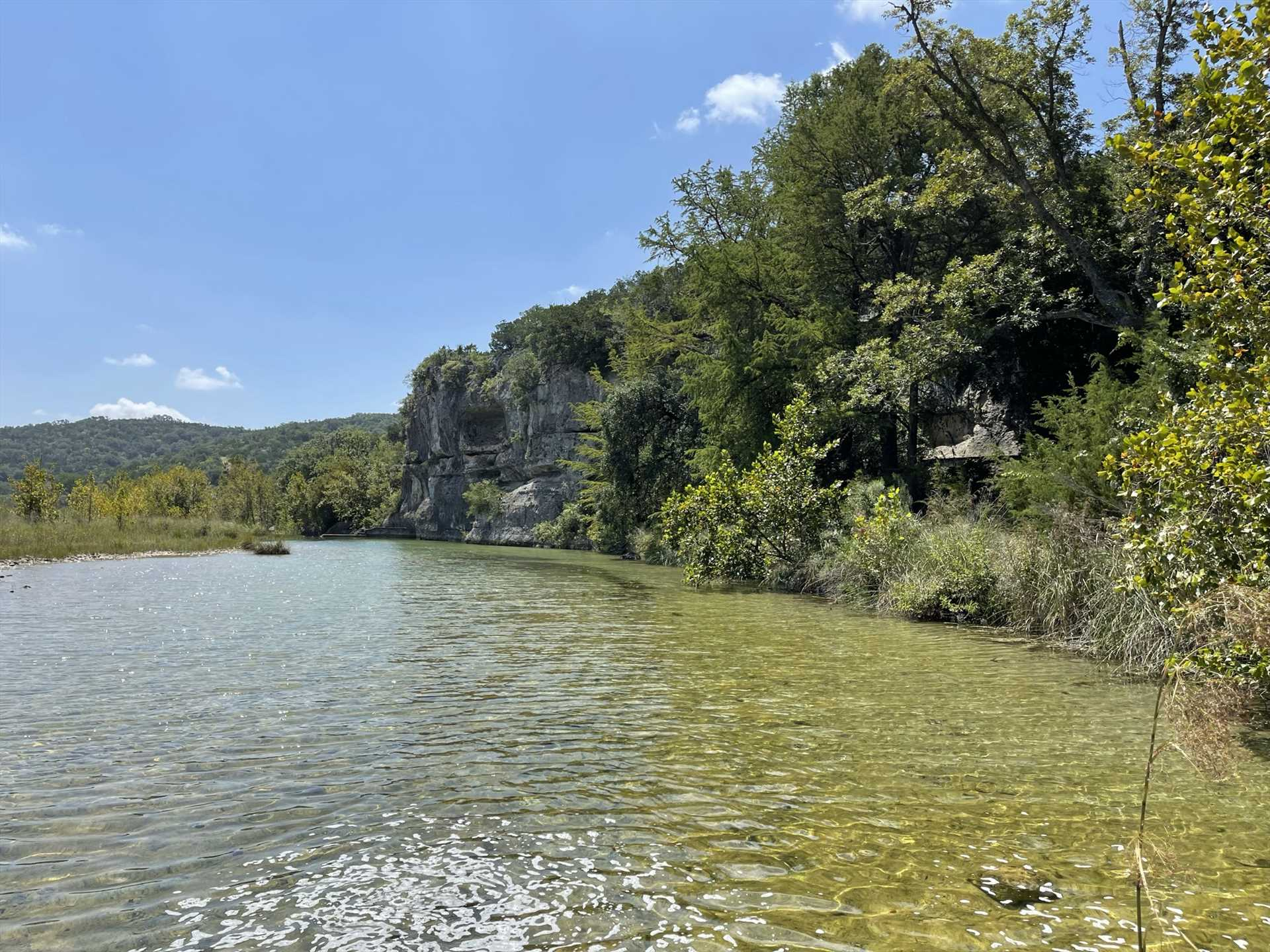 This scenic stretch of the Dry Frio has been dammed to create a swimming hole just for our guests-and check out those amazing mountain views!