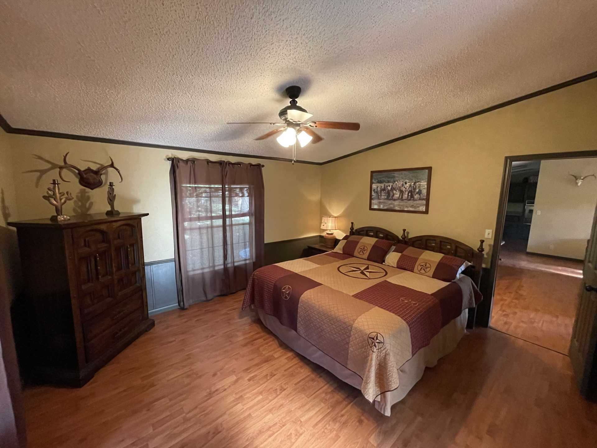 The first bedroom is warmly decorated, and features a big, soft king-sized bed. Fresh bed and bath linens can be provided for a reasonable fee.