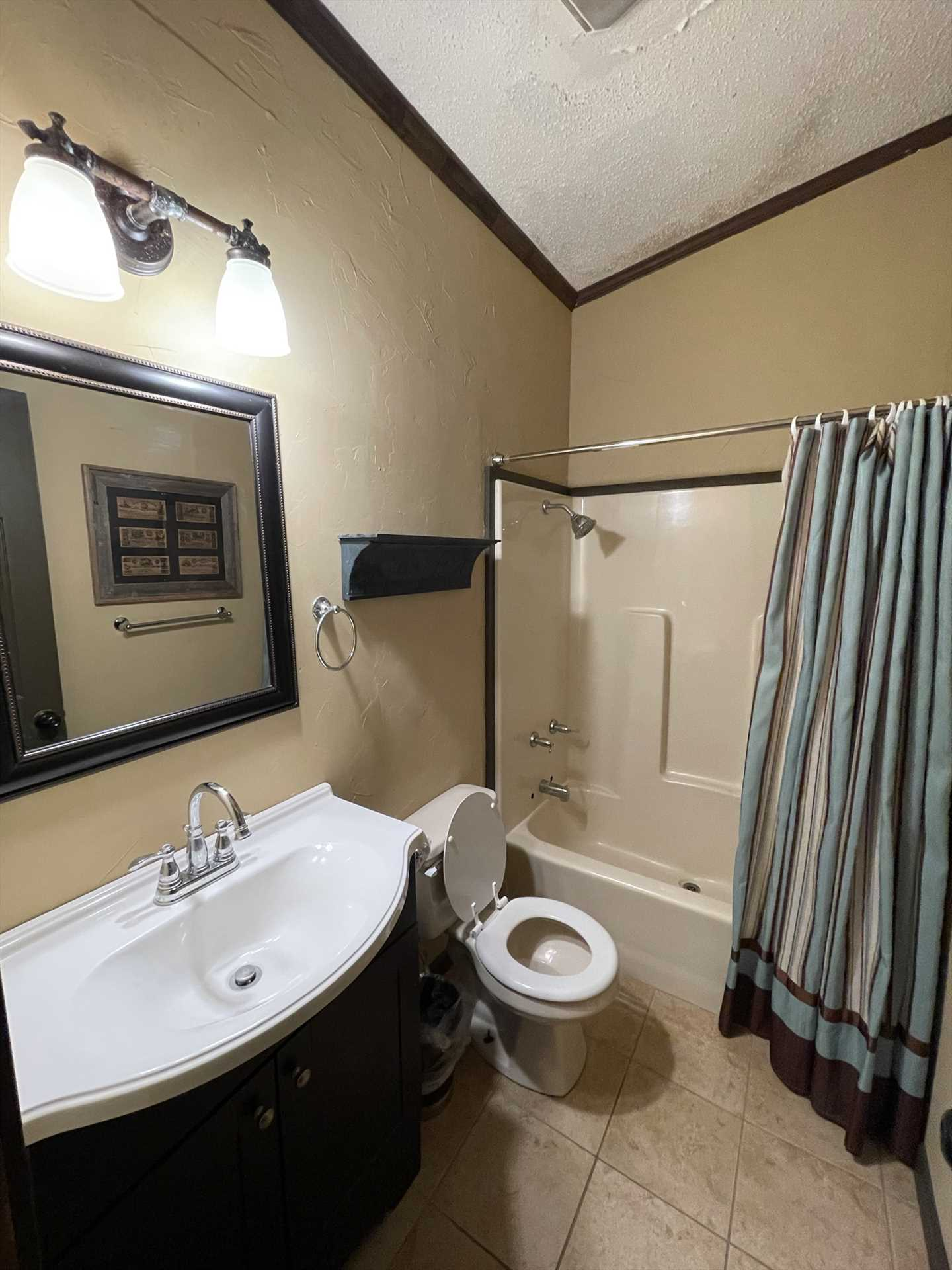 A second bathroom is not only sparkling clean, but also features a tub and shower combo.