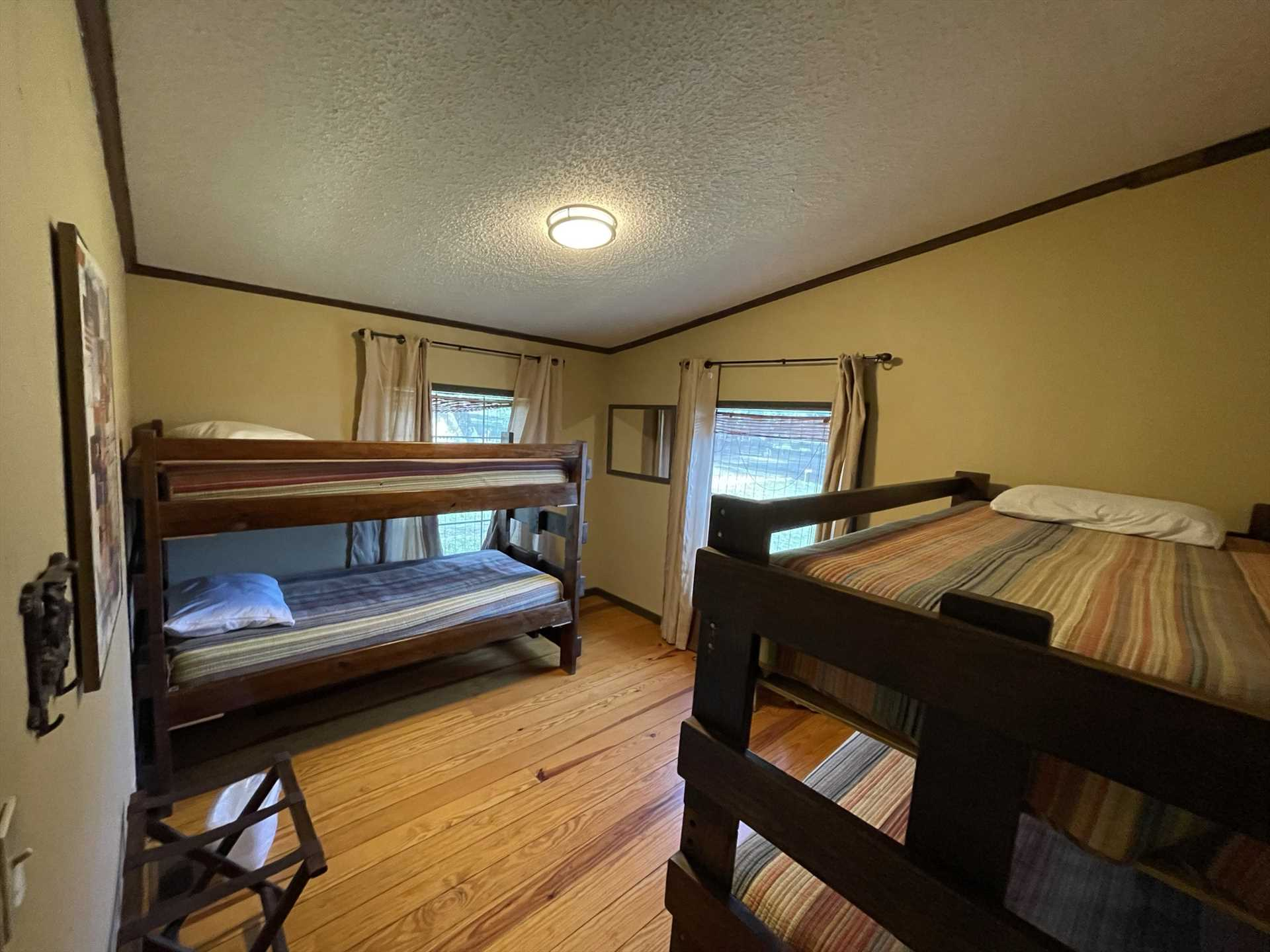 Two sets of twin bunk beds can be found in the second bedroom, offering comfortable sleeping accommodations for up to four.