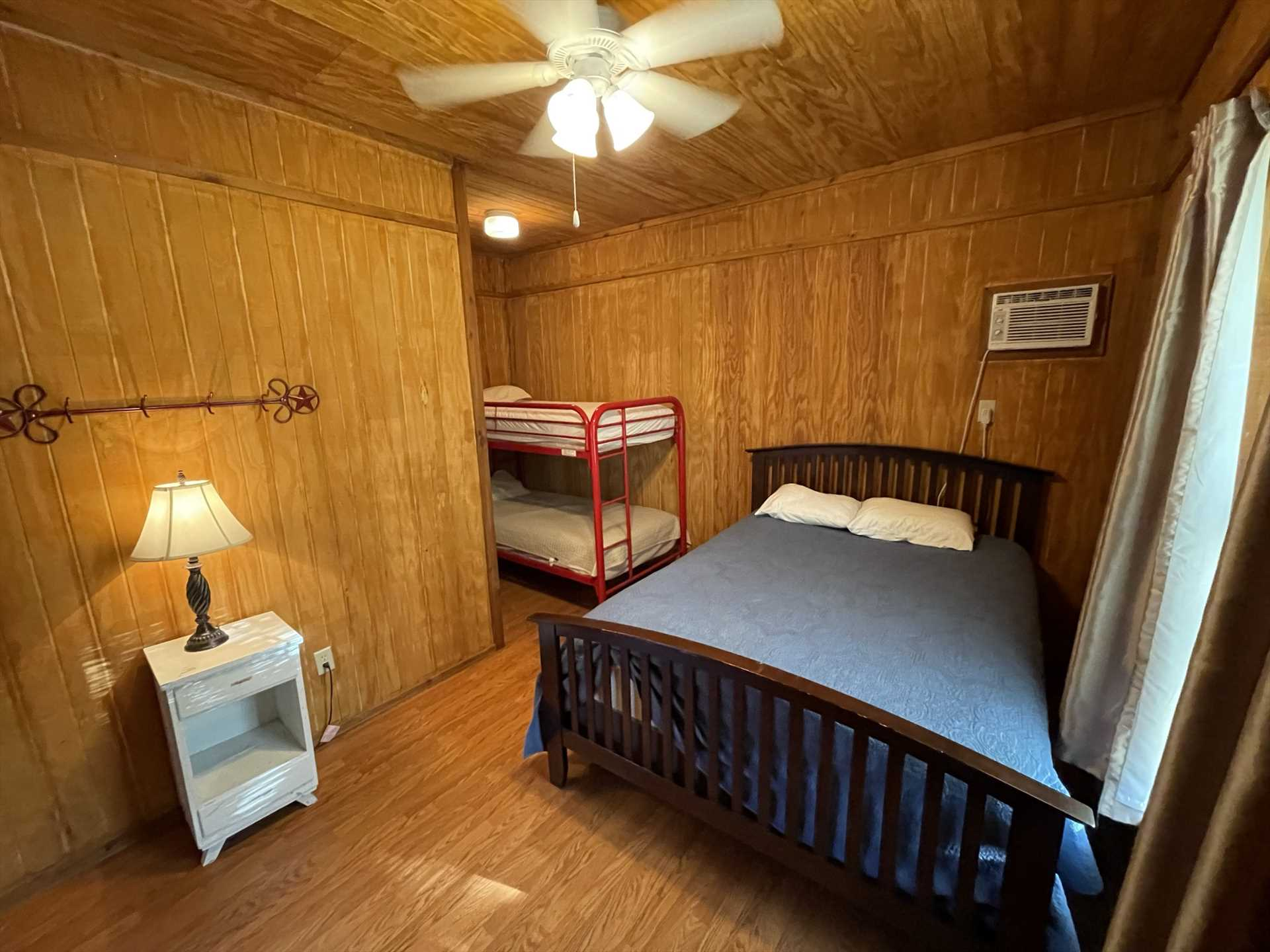 The two cozy bedrooms in the Gone Fishin' Cabin provide comfy slumber for up to six of your folks.