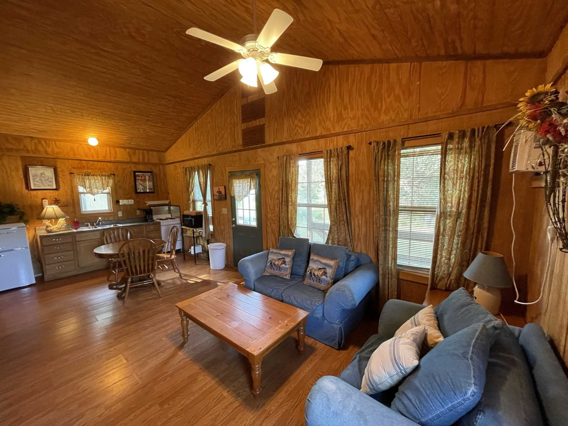 Plenty of leg-stretchin' space greets your folks at the Lone Star Cabin, including a full kitchen, dining table, and warm and welcoming living area furniture!