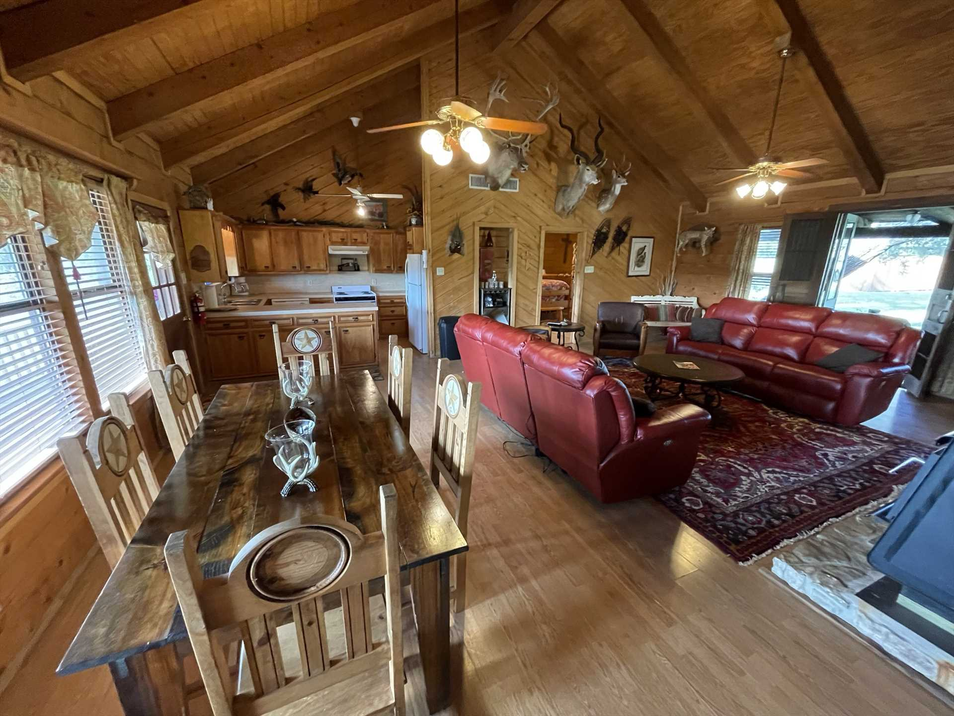 The dining room, fully-stocked kitchen, and living area all come together in the Lodge's open floor plan, so no one misses out on the fun and conversation no matter where they are!