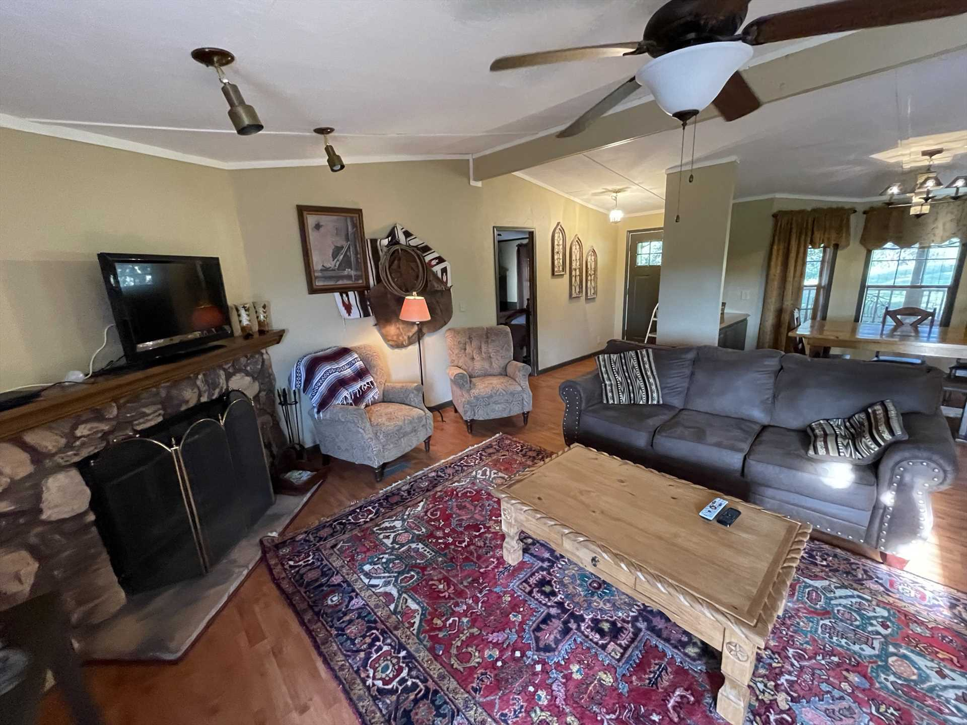 Rio Vista's living area is an amazing hang-out spot, there's a fireplace, smart TV with satellite service, Wifi, and plenty of space and plush furniture.