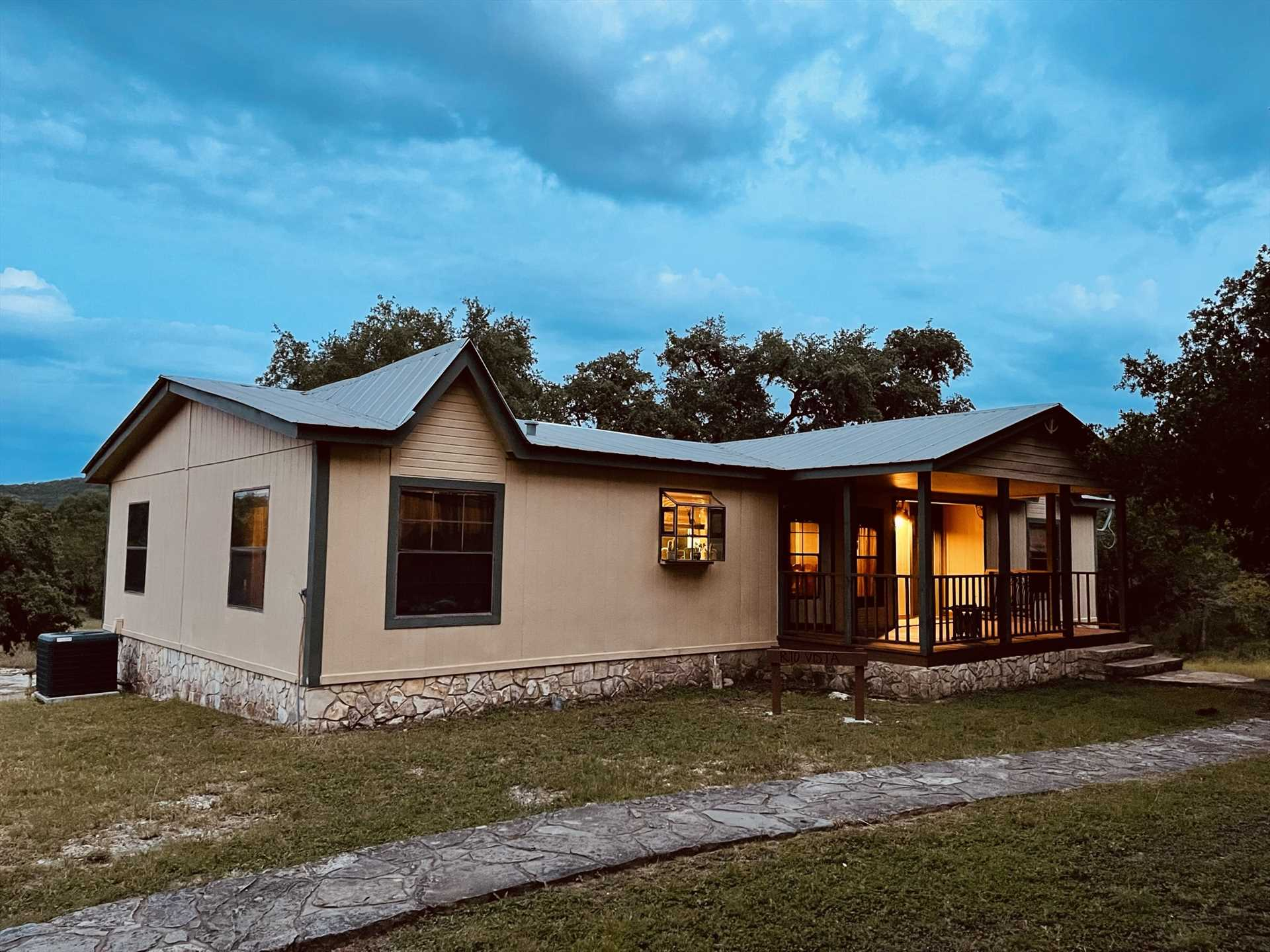 A cozy front porch, an enormous deck out back, and a charcoal grill are just some of the outdoor amenities you'll enjoy at Rio Vista the second of six guest quarters at the Retreat!
